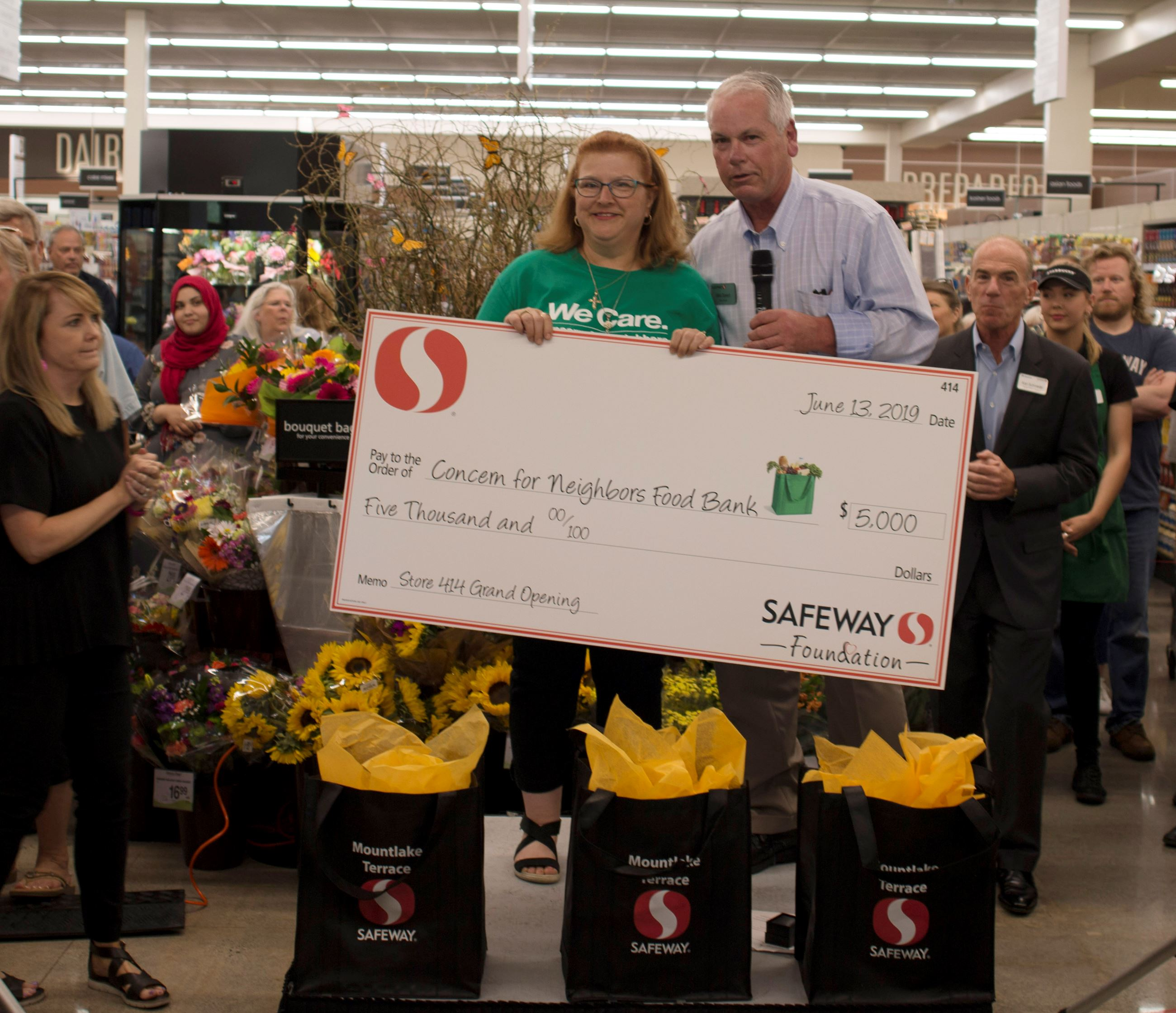 Safeway Manager Presenting Check to Food Bank Representative