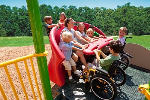 Photo of Universally Accessible Playground Equipment with People of All Abilities