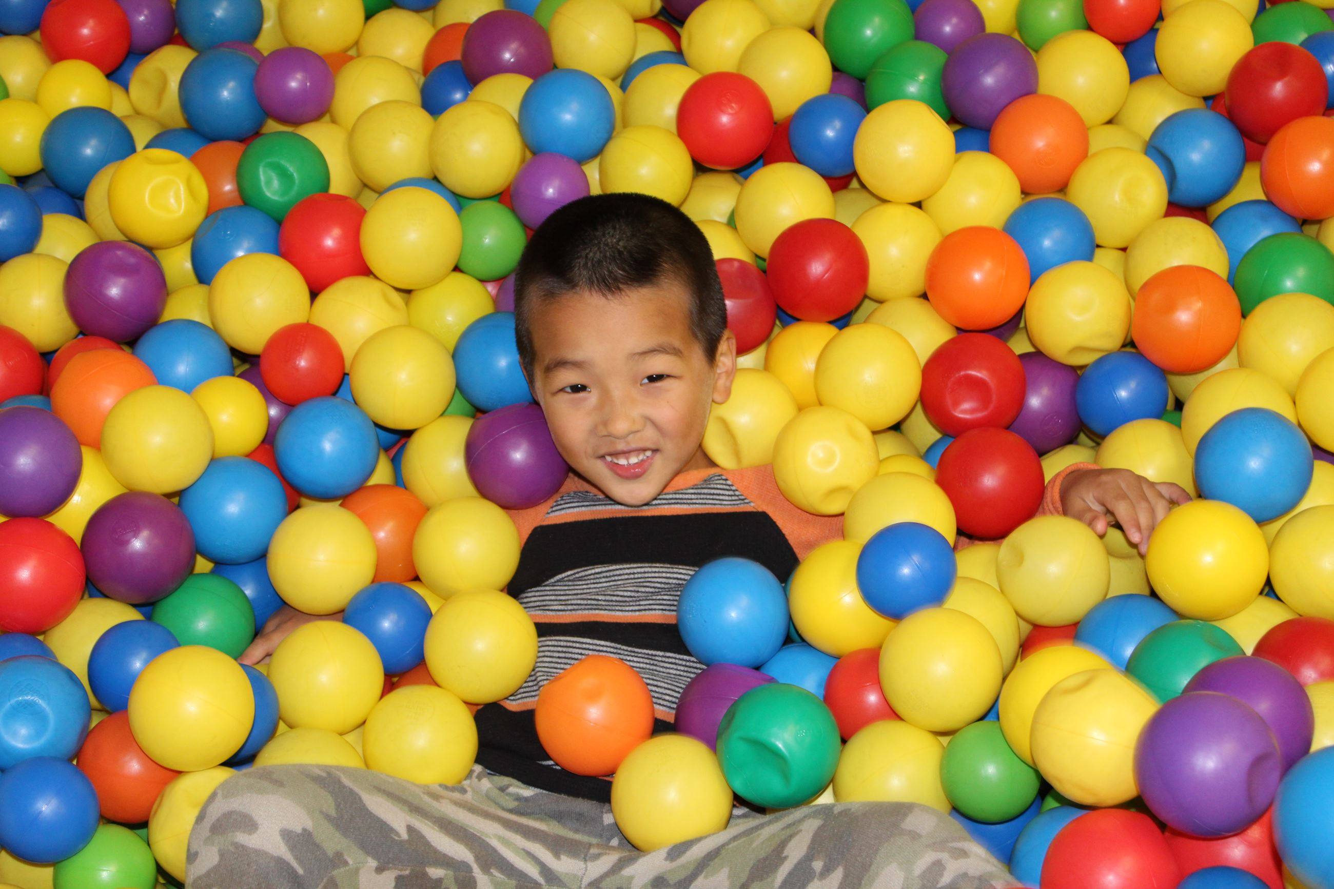 Girl in ball pit at indoor playground
