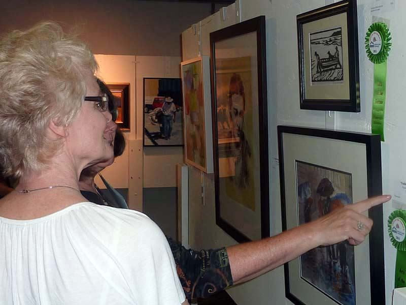 Women observing artwork at the 2011 Arts of the Terrace Juried Art Show.