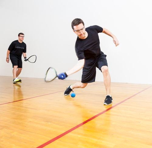 Two Men Playing Racquet