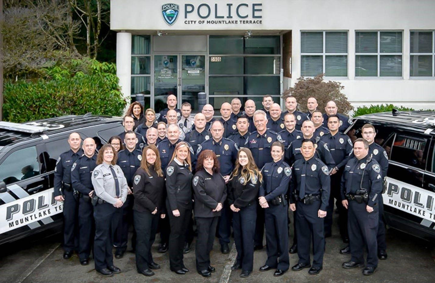 2018 Police department group picture in front of Police building