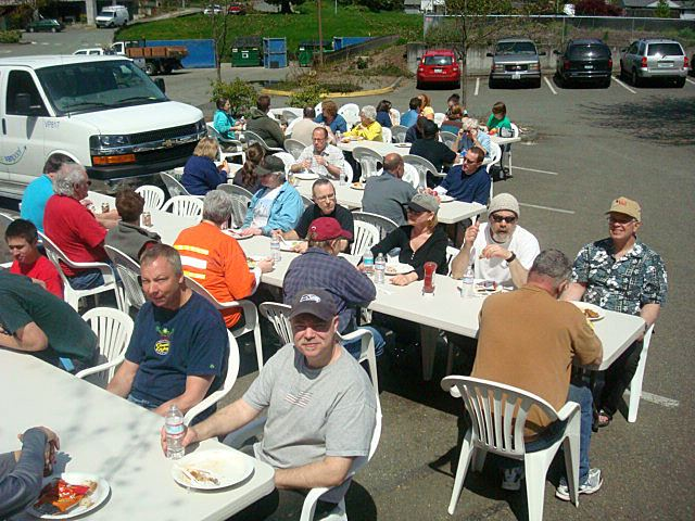 Group sitting down to eat at the 2011 Community Volunteer Cleanup.