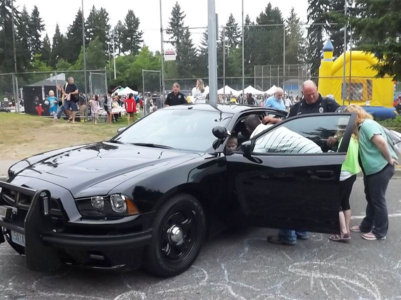 A little boy gets to check out a Police Officer's Charger.