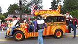 Yellow and red Western Vigilantes car in parade.